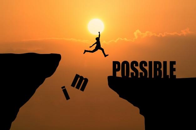homem-saltando-sobre-o-impossivel-ou-possivel-sobre-o-penhasco-no-fundo-do-por-do-sol-ideia-de-conceito-de-negocios_1323-266